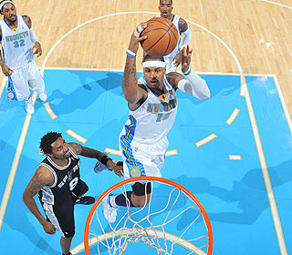 Carmelo Anthony, who finishes with 35 points, comes to the Nuggets' rescue in the fourth. (Getty Images)