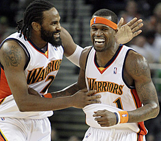 Ronny Turiaf congratulates Stephen Jackson, who notches his first career triple-double in the win.  (AP)