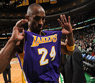 Kobe Bryant, who has 26 points and 10 boards, reminds the fans which team won.