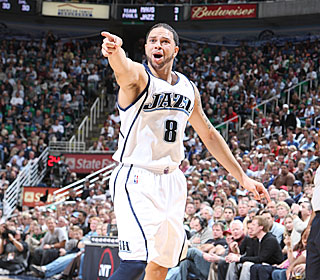 Deron Williams lights up his boyhood hero Jason Kidd, getting 34 points and 12 assists.  (Getty Images)