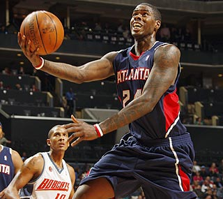 Marvin Williams nails 18 of his 20 free-throw attempts as he totals 29 points for Atlanta.  (Getty Images)