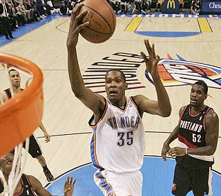 In the first matchup between the top two picks of '07, Kevin Durant (left) scores 31 to Greg Oden's four.  (AP)