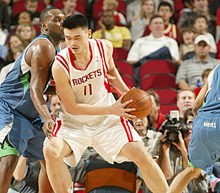 In a marquee matchup, Yao Ming and Al Jefferson refuse to give an inch.  (Getty Images)