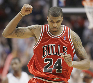 Tyrus Thomas plays a role in the Bulls' comeback effort by scoring 22 points against Detroit.  (AP)