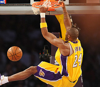Kobe Bryant must be feeling better. He reaches 23,000 points and throws down a nasty dunk.  (Getty Images)