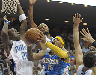 'Melo erupts for 29 points to help lead the Nuggets to their first win in Orlando since 1992.  (AP)