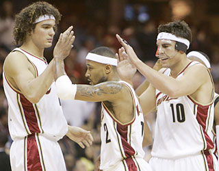 Mo Williams (center), who drops a career-high 44 points, is receiving plenty of love these days.  (AP)