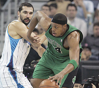 Peja Stojakovic and the Hornets fail to slow down Paul Pierce, who scores 30 points to propel his Celtics.  (AP)