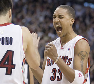 Jason Kapono and Jamario Moon celebrate after holding off the Spurs by a single bucket.  (AP)
