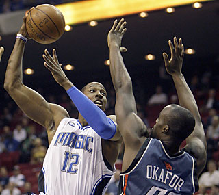 Dwight Howard flexes his muscles by producing 45 points, 19 rebounds and eight blocks.  (AP)