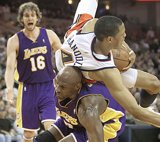 Lamar Odom not only helps carry the Lakers to victory, he also takes Anthony Randolph for a ride.  (AP)