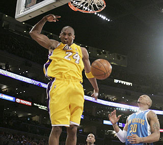 Kobe Bryant takes charge in overtime, scoring 11 of his 39 points in the extra frame.  (AP)