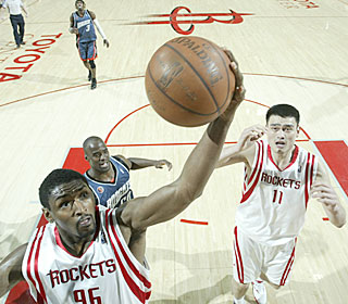 Ron Artest and Yao Ming combine for 45 of the Rockets' 99 points on Sunday.  (Getty Images)