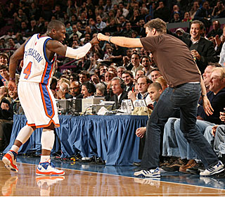 Nate Robinson is greeted by actor Will Ferrell during the guard's 41-point outburst.  (Getty Images)