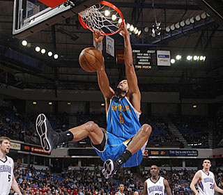 In his first game back from an ankle injury, Tyson Chandler gets 15 points and 10 boards.  (Getty Images)
