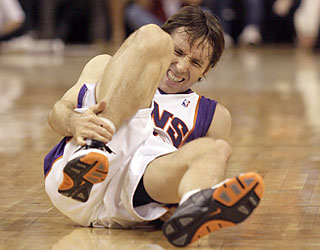 Steve Nash (22 points) hurts his right ankle in the third quarter, but manages a brief return in the fourth.  (AP)