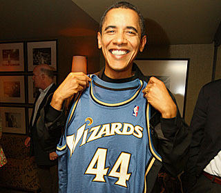 President Obama shows off his Wizards jersey during halftime of Washington's win.  (Getty Images)