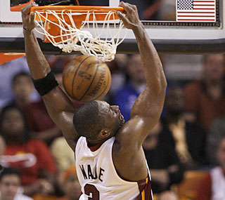 Dwyane Wade, who scores 46 points, slams the door on the Knicks after they give him a bloody lip.  (AP)