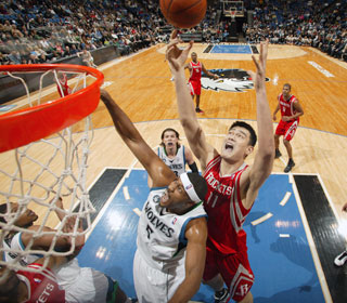 The short-handed, undersized Timberwolves have no answer for the 7-feet-6 Yao Ming.  (Getty Images)