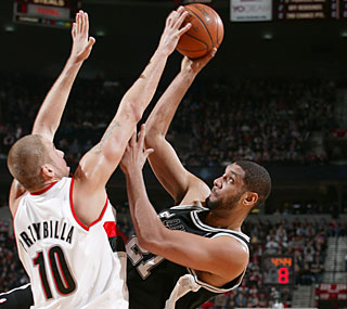 Joel Przybilla and the Blazers deny Tim Duncan (14 points) a win in his first game back.  (Getty Images)