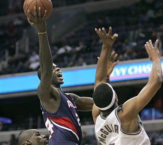 Marvin Williams (28 points) scores eight of the Hawks' first 10 points in the fourth quarter.  (AP)