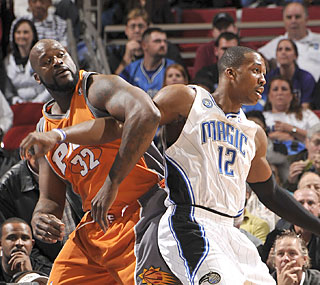While Shaq beats Dwight in the rebound battle, Howard scores more points -- and gets the win.  (Getty Images)
