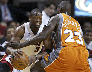 D-Wade works hard to help lead the Heat to their second-highest point total in team history.  (AP)