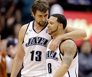 Mehmet Okur appreciates Deron Williams' double-digit assists for the 11th consecutive game.  (AP)