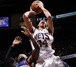 Devin Harris hits 12 of 22 shots from the floor for the Nets, who had lost three of four.  (Getty Images)