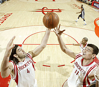 Luis Scola and Yao Ming pull in most of the rebounds Sunday, combining for 31 boards.  (Getty Images)
