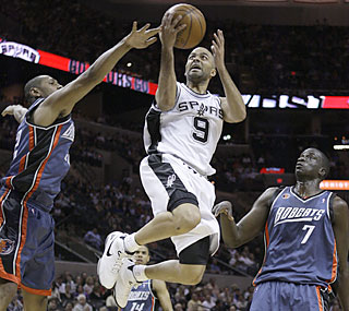 Tony Parker (21 points) delivers a high-flying effort to help the Spurs end the Bobcats' record run.  (AP)