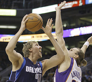 Dirk Nowitzki saves his best stuff for the second half, when he scores 23 of his 34 points.  (AP)