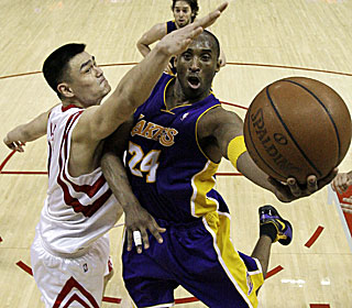 Kobe flies past Yao Ming and finishes with 37 points as L.A. snaps Houston's home winning streak.  (AP)