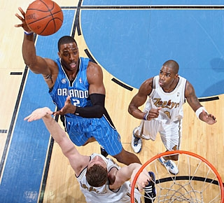 Dwight Howard makes 6 of 9 shots and also comes up with a career-best seven assists. (Getty Images)