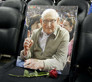 A memorial for late owner Bill Davidson is set up in the front row before the game.  (AP)