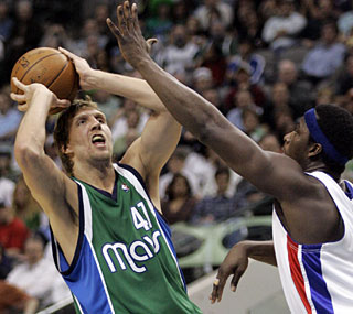 Dirk Nowitzki totals 30 points as the Mavs finally take advantage of a short-handed team. (AP)