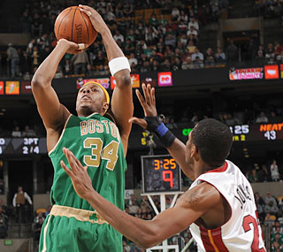 Paul Pierce (36 points) steps up his game for the short-handed Celtics, who beat Miami in OT.  (Getty Images)