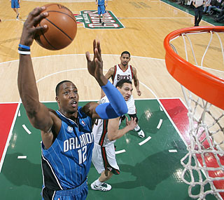 Dwight Howard finishes three assists shy of achieving his second career triple-double.  (Getty Images)