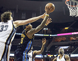 Marc Gasol's Grizzlies have no solution for 'Melo, who helps the Nuggets rally from 17 points down.  (AP)