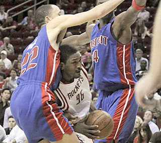 The Pistons fail to slow down Ron Artest, who posts 26 points in the Rockets' double-overtime win.  (AP)