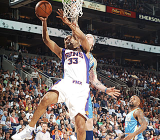 Grant Hill turns back the clock by scoring a team-high 23 points.  (Getty Images)
