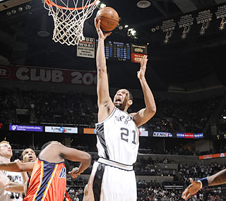 Tim Duncan scores 13 of his 21 points in the fourth to help the Spurs get by the Warriors.  (Getty Images)