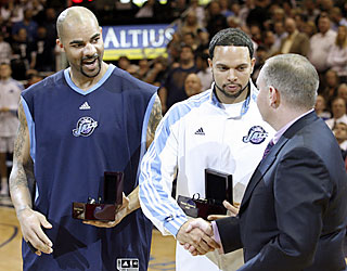Carlos Boozer and Deron Williams receive U.S. Olympic basketball rings before the game. (AP)