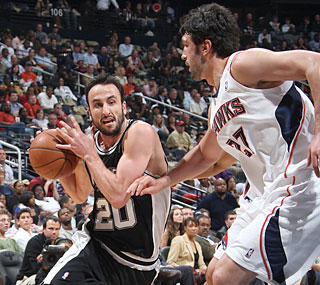 Manu Ginobili scores two points in limited action after returning from a 19-game absence.  (Getty Images)