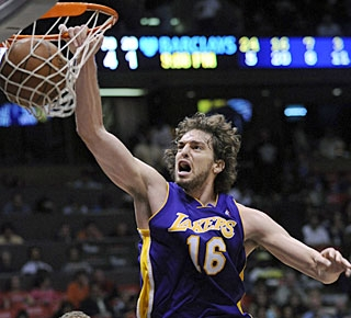 Pau Gasol, who pulls down 11 rebounds, misses a triple-double by just three assists. (AP)