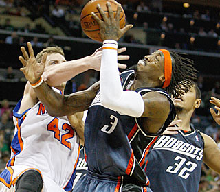 Gerald Wallace takes some hits during his 23-point, nine-board, eight-assist game.  (Getty Images)