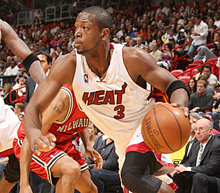 Dwyane Wade does a little of everything, getting 27 points, seven assists and four boards.  (Getty Images)