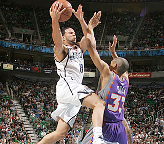 Deron Williams steps up when it counts most, scoring seven of his 21 in overtime.  (Getty Images)
