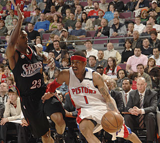 Allen Iverson provides eight points in limited action during his first game back.  (Getty Images)