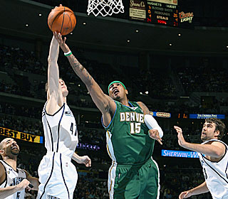 Carmelo Anthony scores 23 points to help the Nuggets reach the 50-win plateau.  (Getty Images)